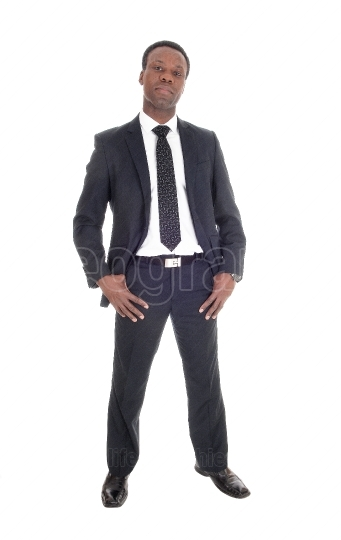African man standing in suit and tie