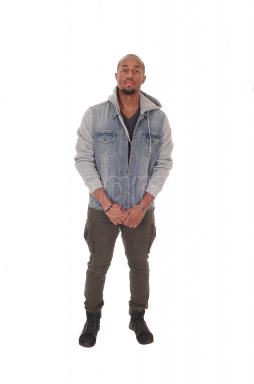 African man standing relaxed in a jeans jacket