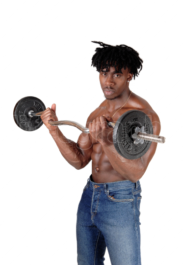 African man standing shirtless lifting weights