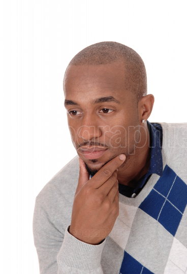 African man with his hand on his chin, thinking
