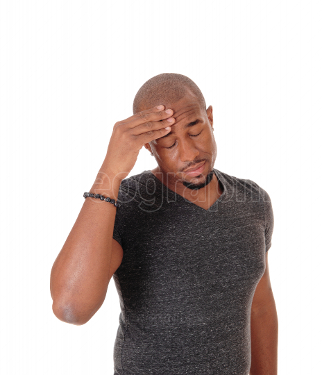 African man with his hand on his head, thinking