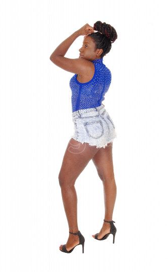 African woman standing in shorts in profile