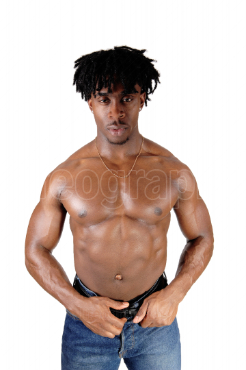 African young man standing shirtless showing his body