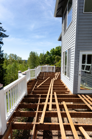 Aged outdoor wooden cedar deck tear down due to weathered boards
