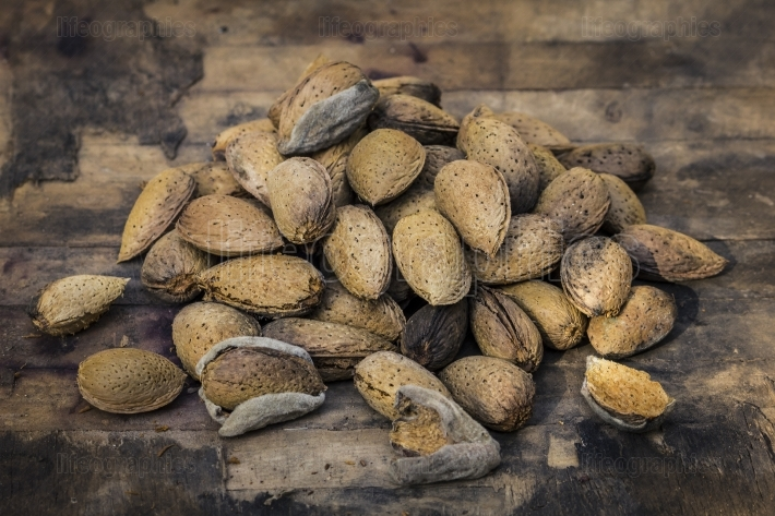 Almonds on an old wood background