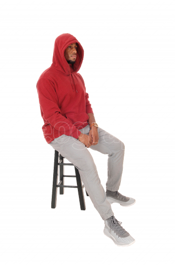 An African man in a burgundy hoody