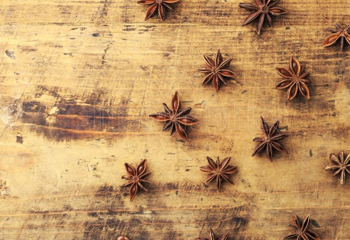 Anise stars on wood background with place for copyspace
