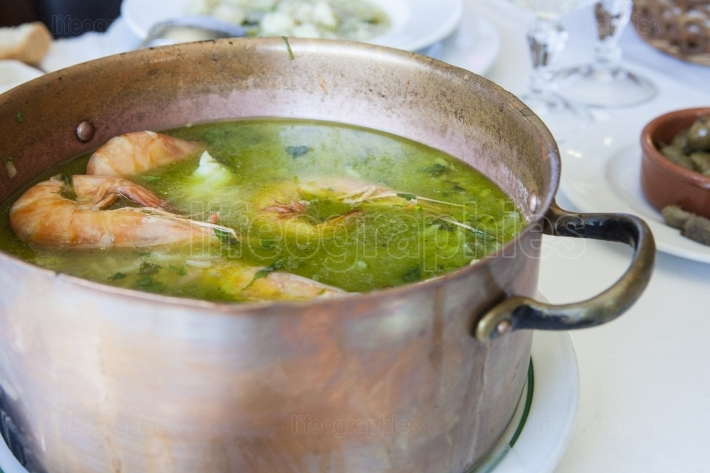Arroz de Tamboril or soupy seafood rice, portuguese recipe