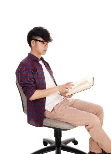 Asian teenager reading book