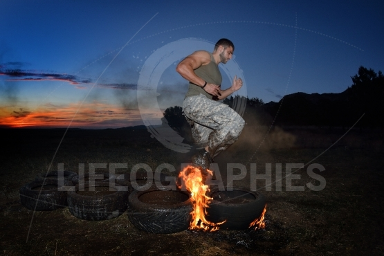 Athletic young man exercising on dusty field