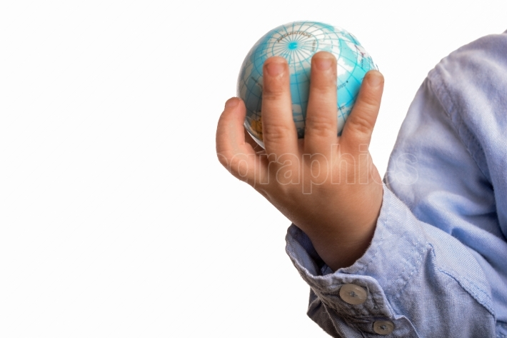Baby holding a globe