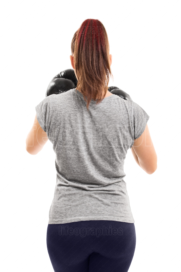 Back shot of a young female boxer