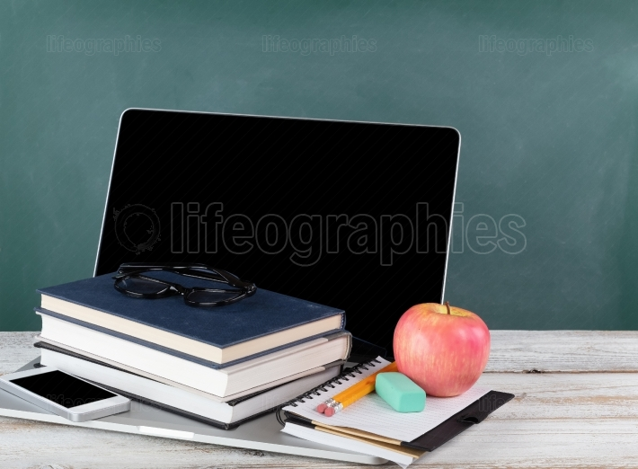 Back to school concept consisting of technology and traditional