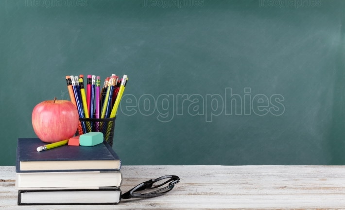 Back to school concept including books and stationery supplies w