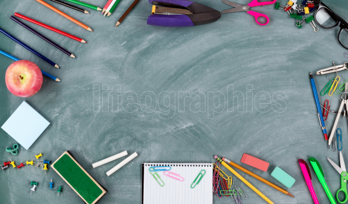 Back to school concept with green chalkboard and a variety of s