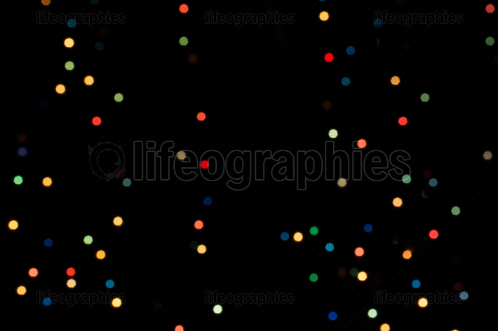 Background With   multi color bokeh lights