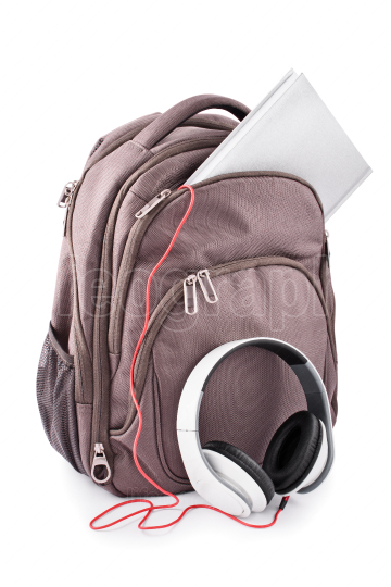 Backpack with headphones and notebook