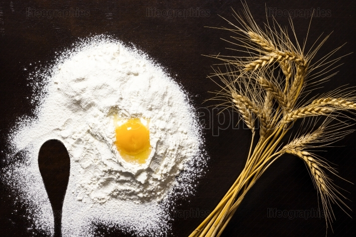 Baking background.Yolk in flour and wheat
