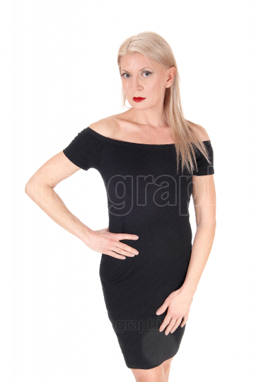 Beautiful blond woman stand in black dress