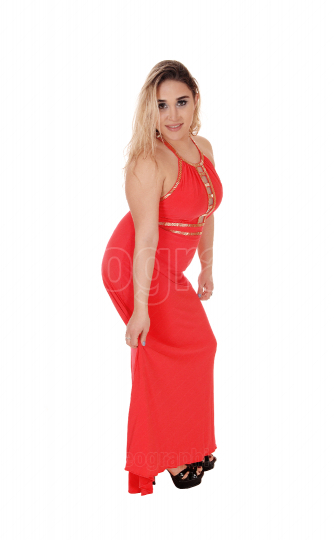 Beautiful blond woman standing in red dress