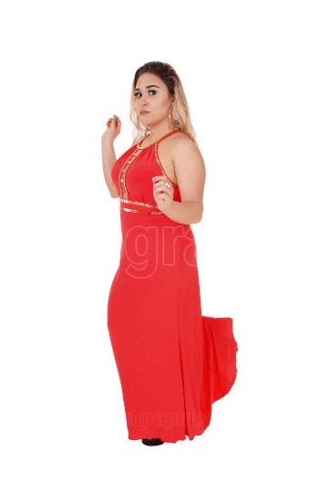 Beautiful blond woman standing in red dress dancing