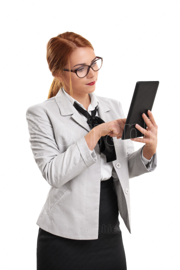Beautiful businesswoman in a suit with tablet in hand