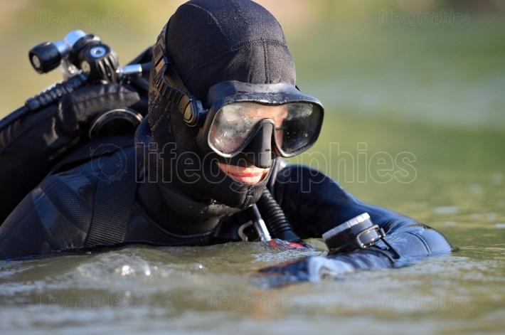Beautiful caucasian diver woman in the water