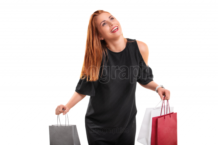 Beautiful excited young woman with shopping bags