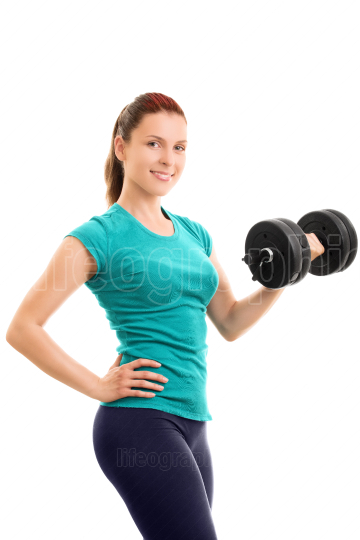 Beautiful fit girl holding a dumbbell