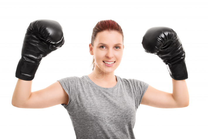Beautiful girl with boxing gloves cheering