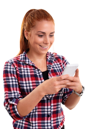 Beautiful smiling young woman looking at mobile phone