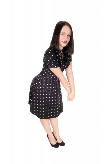 Beautiful woman standing in an pock dot dress