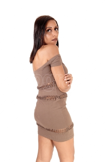 Beautiful woman standing in brown dress
