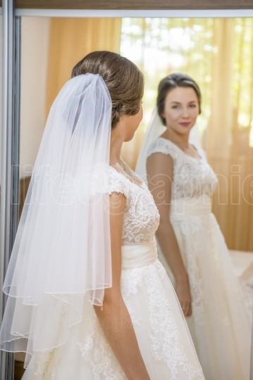 Beautiful young bride in wedding dress