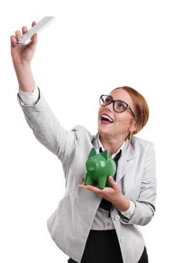 Beautiful young business woman taking a selfie with a piggy bank
