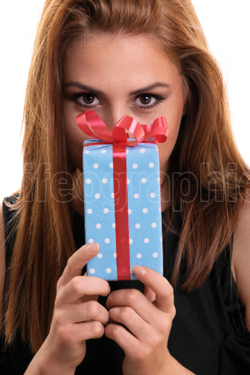 Beautiful young girl holding a gift