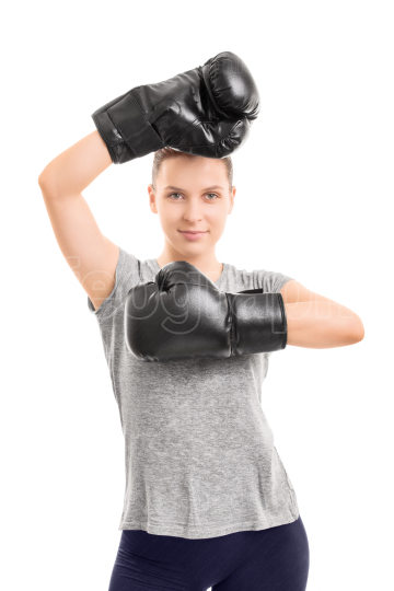 Beautiful young girl with black boxing gloves
