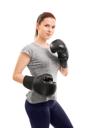 Beautiful young girl with boxing gloves