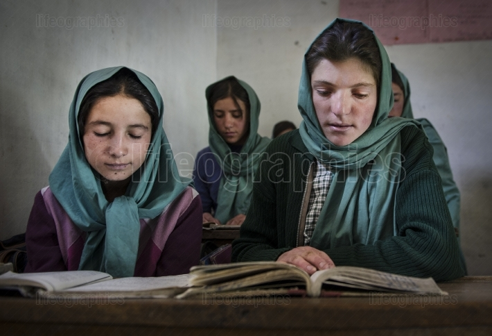 Beautiful young girls learning  at government school from Shimshal village