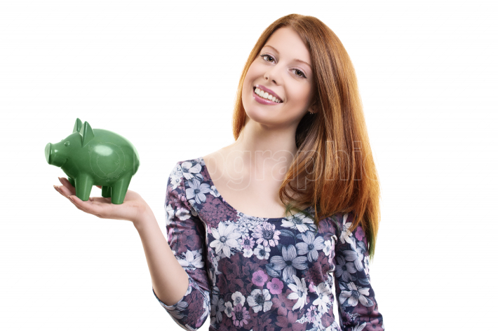 Beautiful young woman holding a green piggy bank
