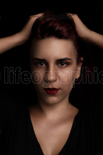 Beauty portrait of a young woman on black background