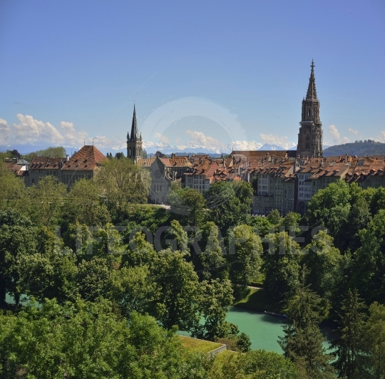 Berner oberland (swiss alps) with the cathedral of bern view from kornhausbr?cke