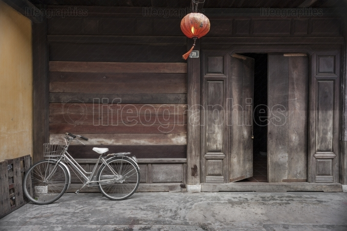 Bike parked outside an ancient house in Hoi An village