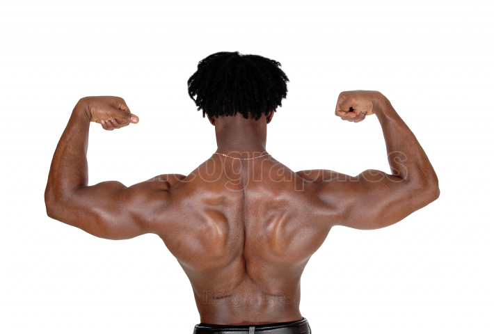 Black man standing from the back flexing muscles
