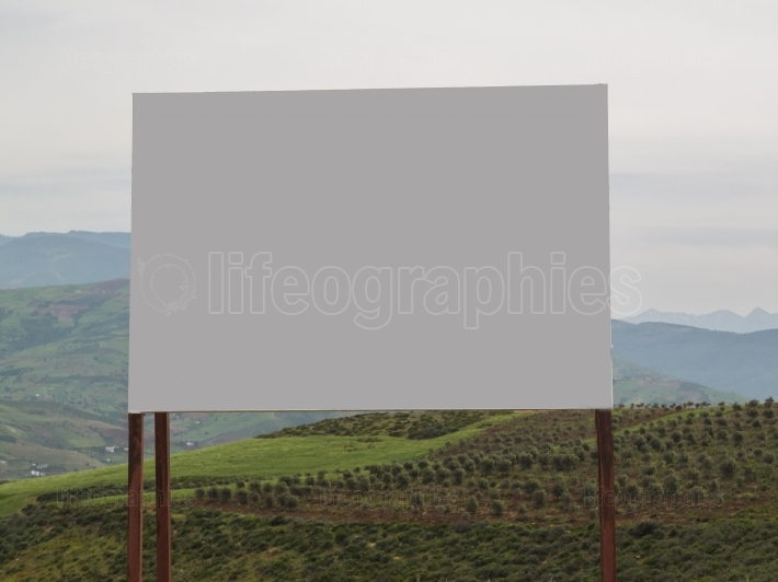 Blank grey road sign board in rural area