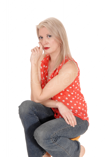 Blond gorgeous middle age woman sitting on chair