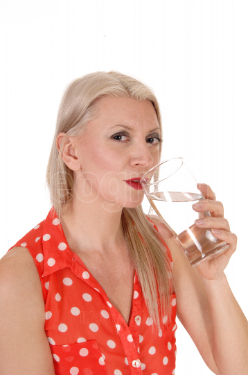 Blond woman gorgeous drinking a glass of water