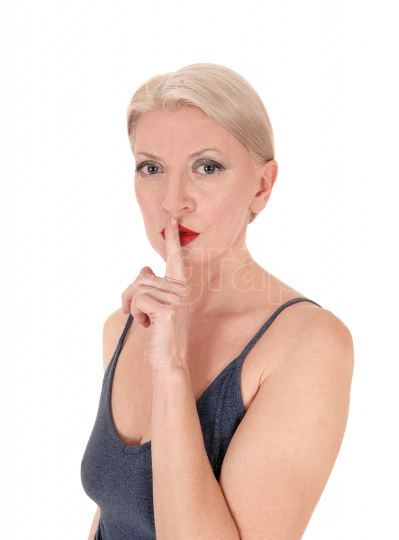 Blond woman in close up with finger over mouth