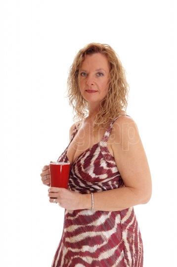 Blond woman with red coffee mug.