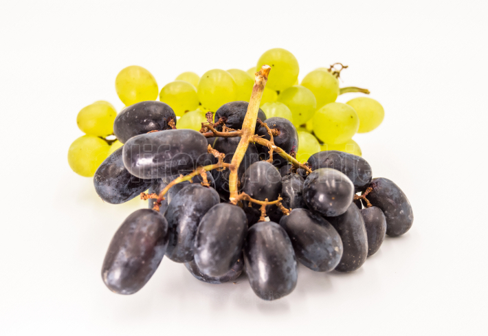 Bunch of blue and green wet grapes isolated